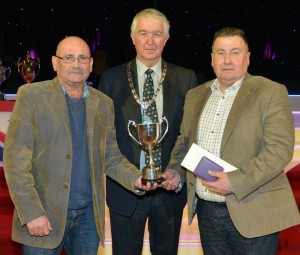P & J Boal from Dromore collect the Selby Thomas Memorial Trophy at the Gala Evening at Tower Ballroom.