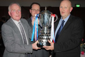 Gerry O'Reilly & Son present the Kings Cup to winner in 2013 Ron Williamson (r).