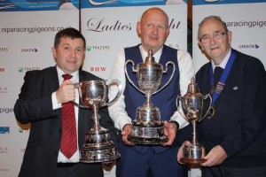 Special guest Robin Swann MLA (l) with St Malo Nat winner Ronnie Williamson. Included NIPA President Robert Reid.