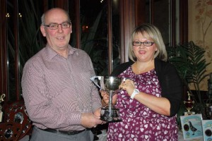 Bertie Blair collects Harper Cup for Highest Prize-winner from Nicola Gilbert.