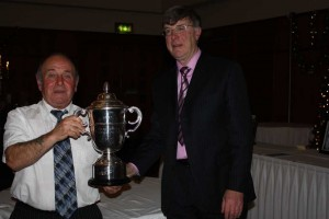 Tommy collects the Darragh Cup at the INFC prize night, best ave Ylr Nat & Quimper.