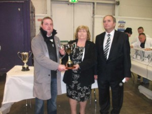 Mrs Bridget Darling presents the new Kevin Darling Memorial Cup to Timmy Mawhinney. President Eugene Fitzgerald is (r).
