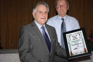 Anthony McDonnell (l) presents the Hall of Fame Diploma to Malcolm Robinson of Bondhill.