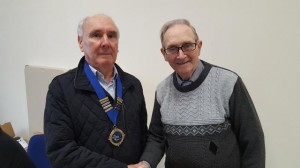 Outgoing President Robert Reid (r) hands over the chain of office to Sammy Briggs.
