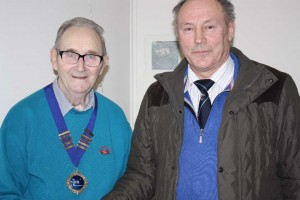 Alan Darragh (r) presents the Chain of Office to new President Robert Reid of Carrick & District.