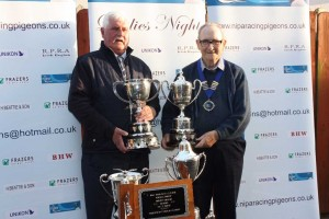 NIPA President Robert Reid (r) presents the St Malo trophies to Speirs & Campbell, Cookstown